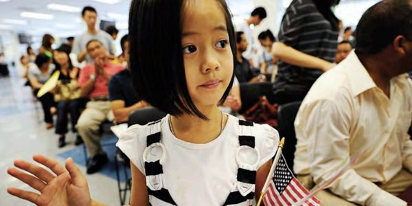 Bolder Together Report Photo Girl with Flag.png